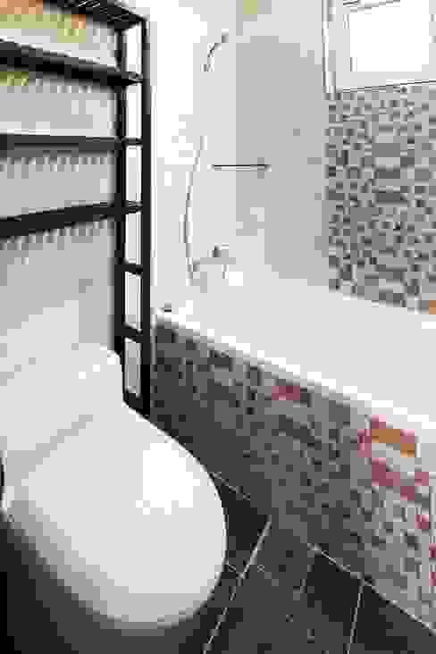 Casas de banho modernas por 윤성하우징 Moderno