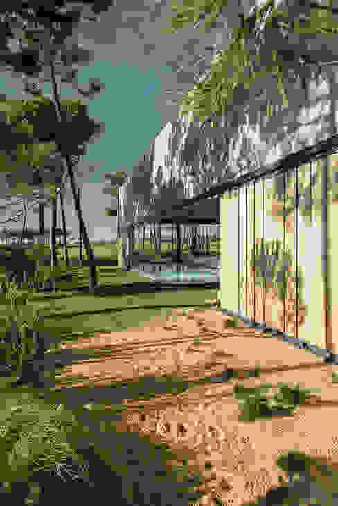 The Wall House: Casas  por guedes cruz arquitectos,