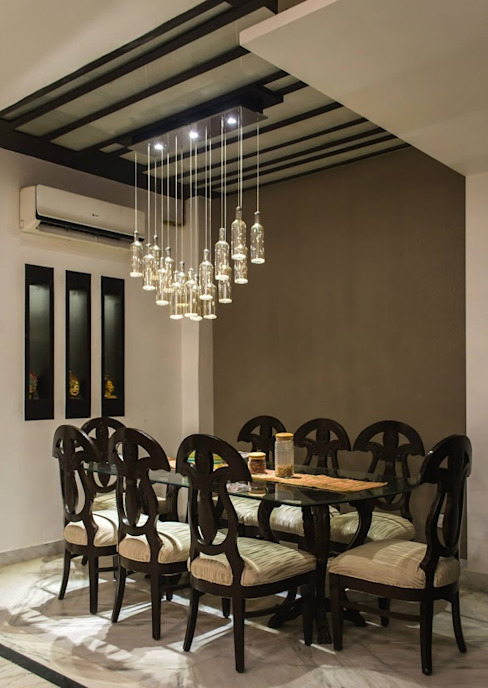 Modern dining room by Studio Ezube Modern