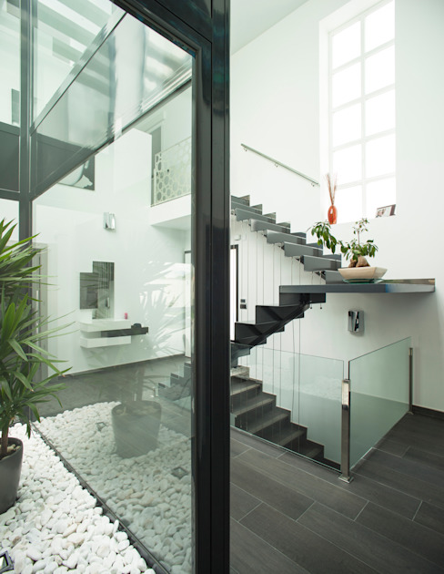 Casa AI Pasillos, vestíbulos y escaleras de estilo moderno de Mascagni arquitectos Moderno