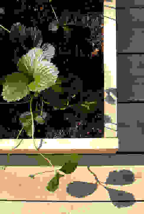 Il giardino comunitario Giardino eclettico di Atelier delle Verdure Eclettico Legno Effetto legno