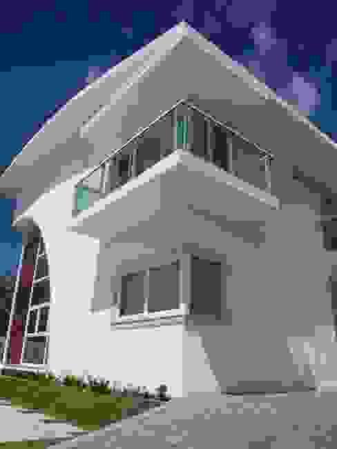 Moderne Häuser von CHASTINET ARQUITETURA URBANISMO ENGENHARIA LTDA Modern Ziegel
