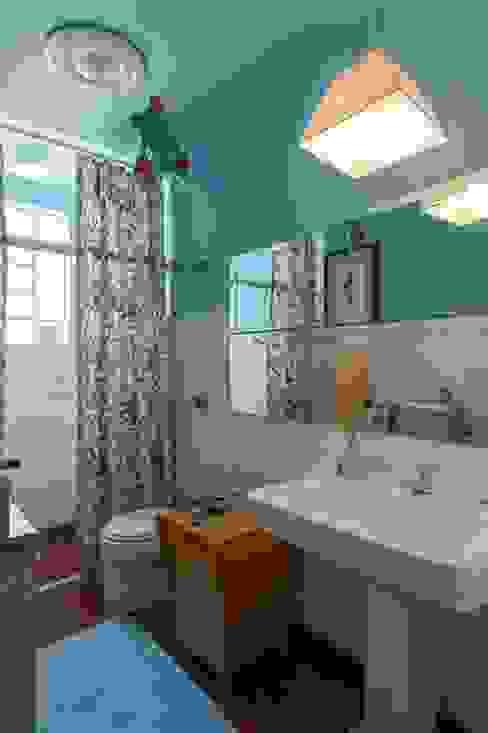 Banho Banheiros ecléticos por Piloni Arquitetura Eclético