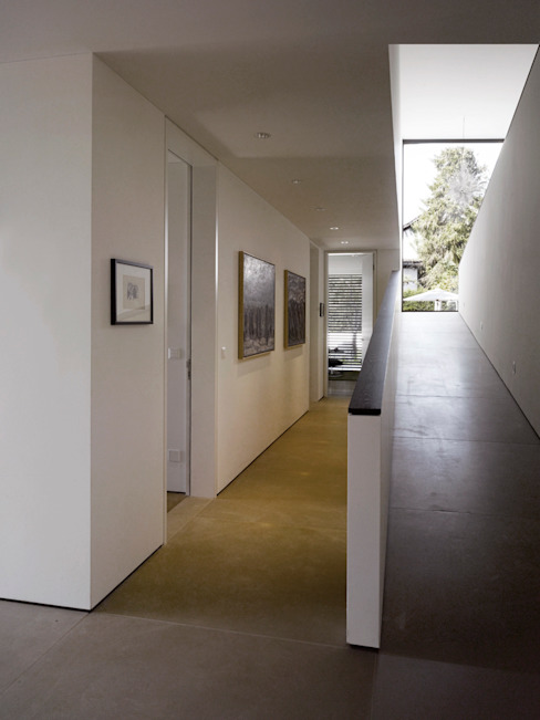 Pasillos y vestíbulos de estilo  de meier architekten zürich, Moderno Hormigón