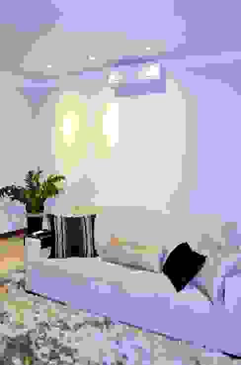Salas de estar modernas por Lozí - Projeto e Obra Moderno