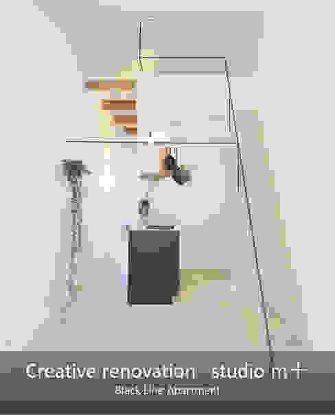 Living room by studio m+ by masato fujii, Modern Iron/Steel