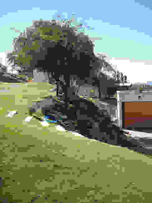 Casa Lago Modern garden by renziravelo Modern