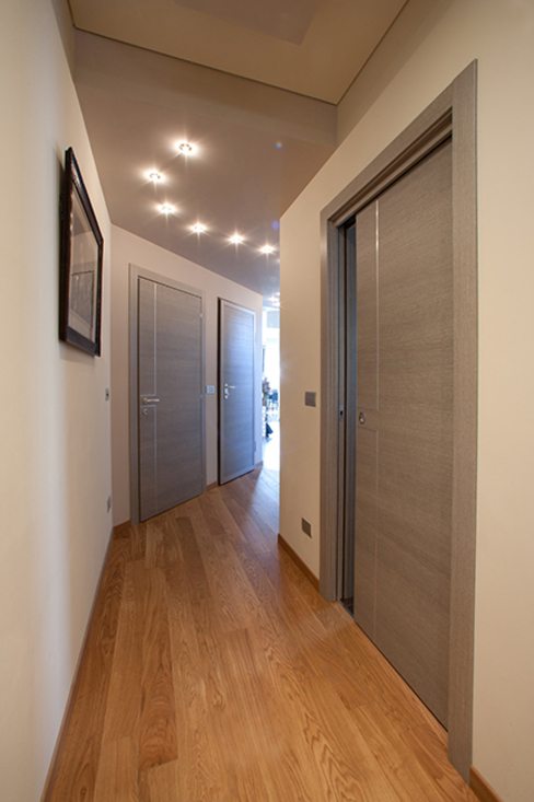 Couloir, entrée, escaliers classiques par Barra&Barra Srl Classique