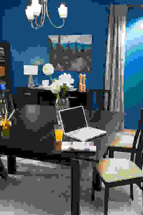 Dining room by Idea Interior,
