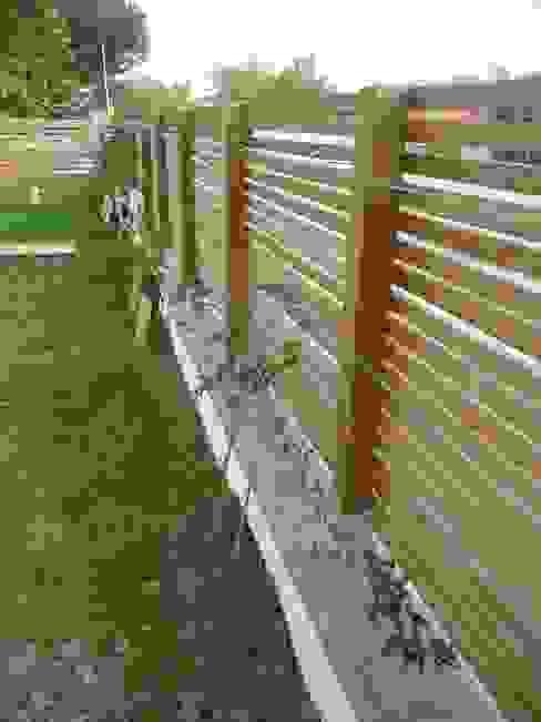 Clôture bois Jardin moderne par Constans Paysage Moderne