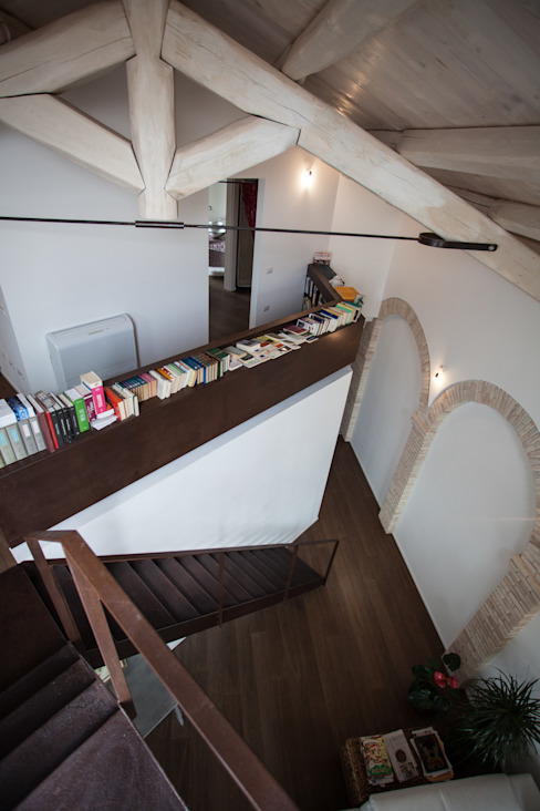 Salones de estilo moderno de STUDIO DOTT. ARCH. GIANLUCA PIGNATARO Moderno Ladrillos