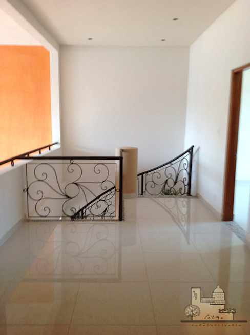 Modern corridor, hallway & stairs by I.S.T.M.O. CONSTRUCCIONES Modern Reinforced concrete