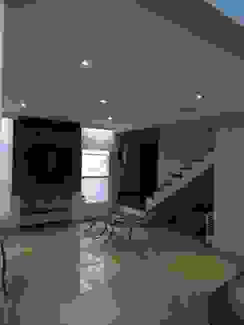 Salas de estilo  por Lozí - Projeto e Obra, Moderno