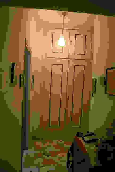 dispensa pre-trasformazione Ingresso, Corridoio & Scale in stile minimalista di antoniodimaro + Partners Minimalista