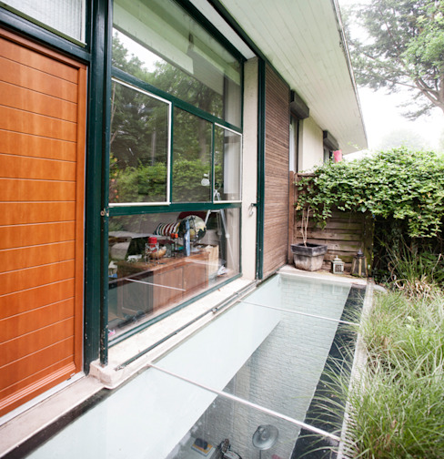 Jardin de style  par homify, Moderne Verre