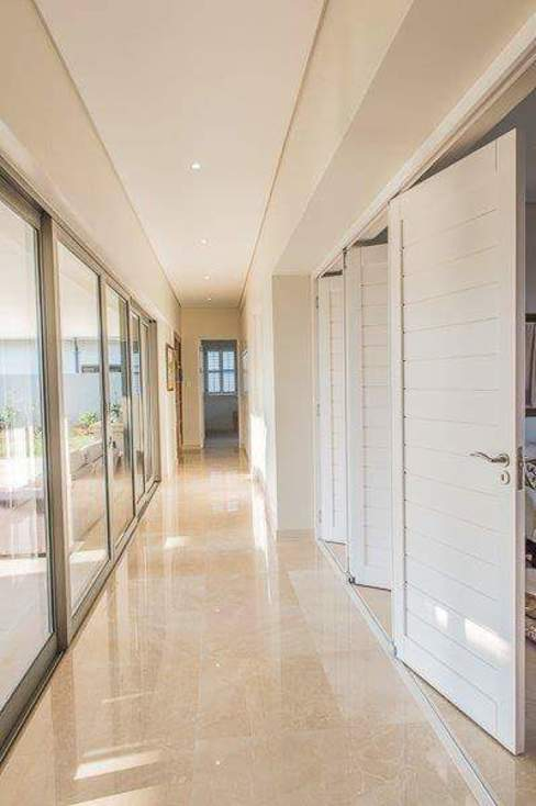 Simple yet beautiful home in Brettenwood Minimalist corridor, hallway & stairs by CA Architects Minimalist