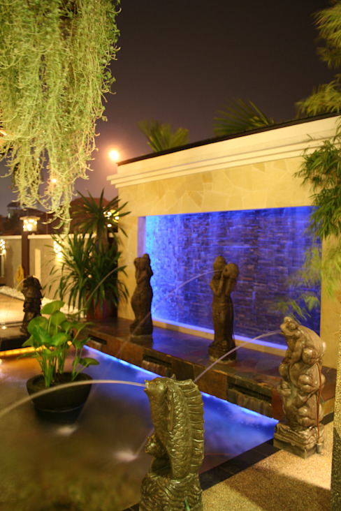 Tropical style houses by Design Spirits Tropical