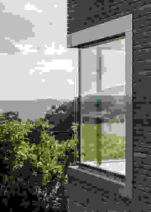Case moderne di RK Next Architekten Moderno