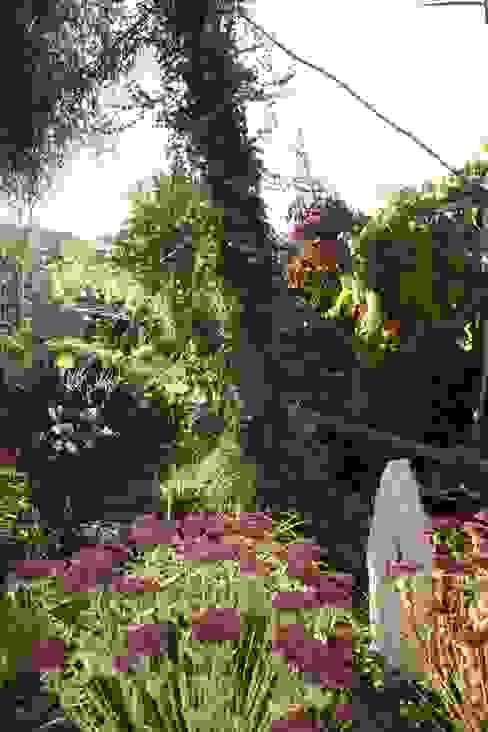 Der plantasie - Garten:  Garten von Gartenarchitekturbüro Timm,Tropisch