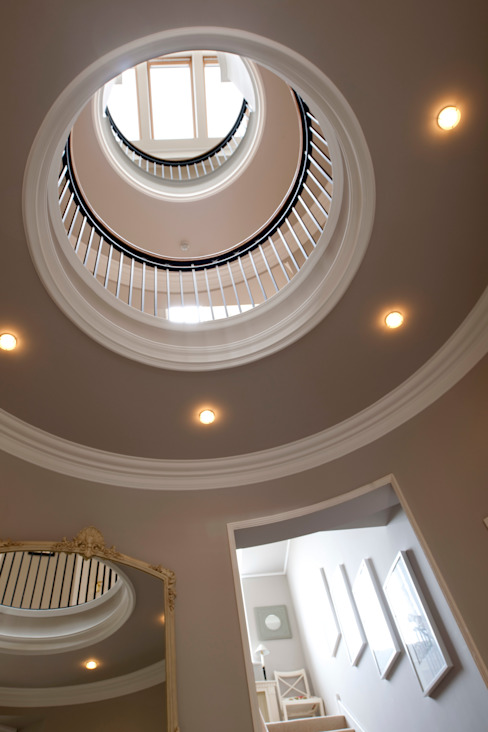 Circular atrium lit from above forms central circulation space to this Italian inspired mansion Classic style corridor, hallway and stairs by Des Ewing Residential Architects Classic