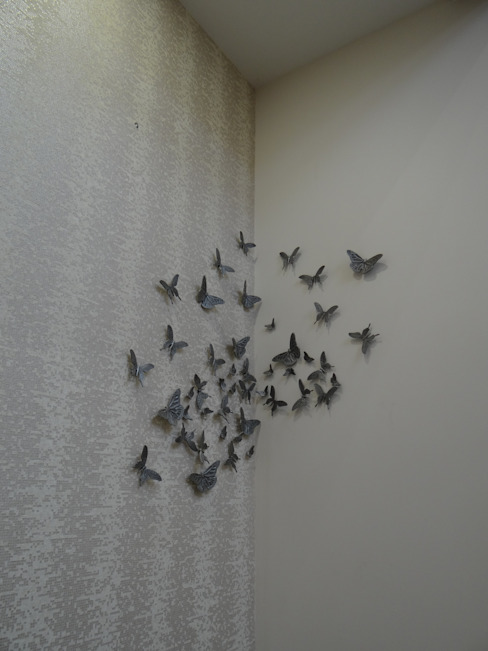 Butterfly motifs on the wall Modern walls & floors by Hasta architects Modern