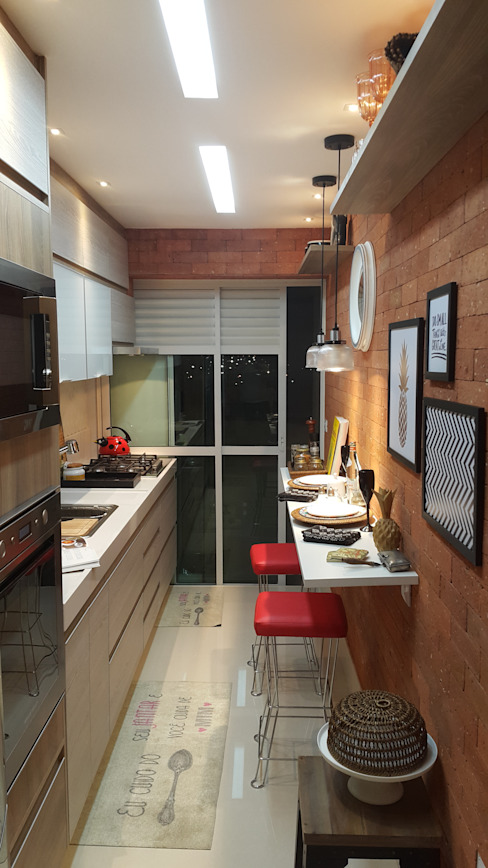 Modern kitchen by Lucio Nocito Arquitetura e Design de Interiores Modern Bricks