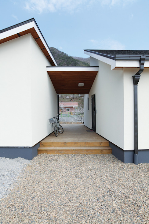 現代房屋設計點子、靈感 & 圖片 根據 춘건축 現代風