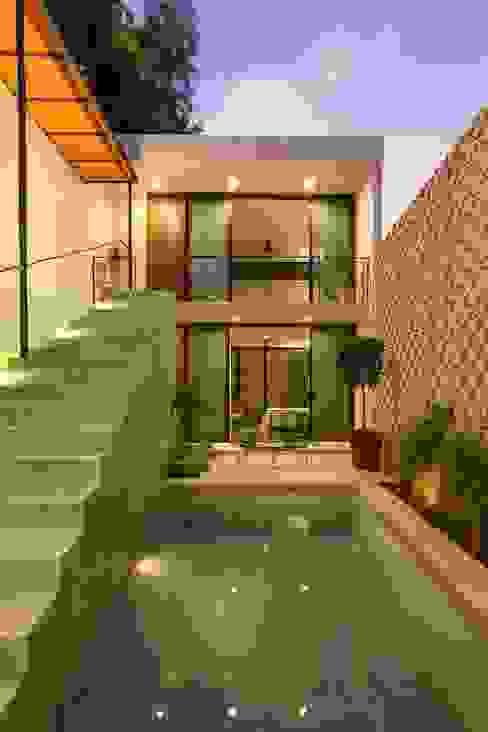 Casas modernas de Taller Estilo Arquitectura Moderno Concreto