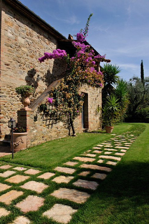 Rustic style house by Arte Pietra Rustic Stone