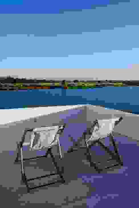 Terraza al lago Balcones y terrazas modernos: Ideas, imágenes y decoración de CIBA ARQUITECTURA Moderno