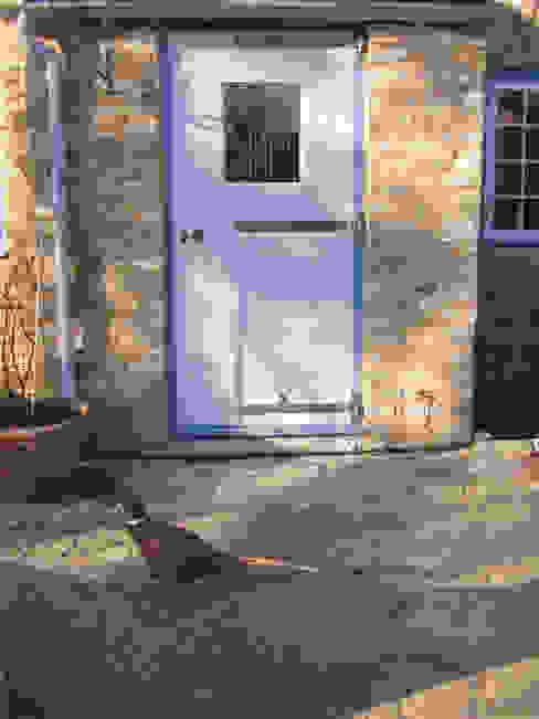 Rear Porch:  Windows & doors  by Clayton Munroe,