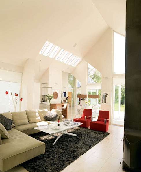 Award winning contemporary house in Co Antrim モダンデザインの リビング の Jane D Burnside Architects モダン
