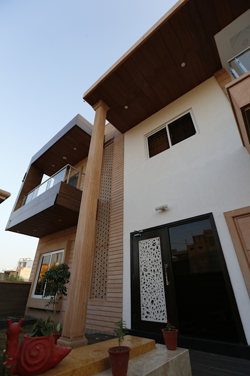 Exterior View of Modern Residence Modern houses by RAVI - NUPUR ARCHITECTS Modern Stone