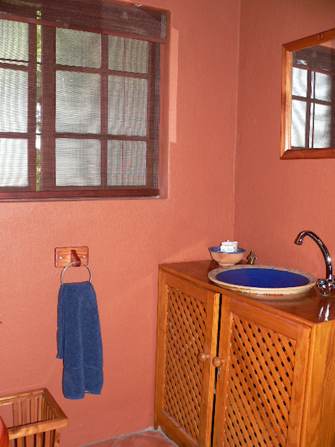 Adding decor and blinds to the guest bathroom:  Bathroom by SOJE Interior, Design and Decor PTY (Ltd)