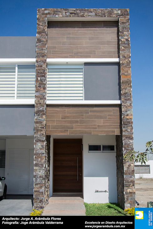 Houses by Excelencia en Diseño, Minimalist Stone