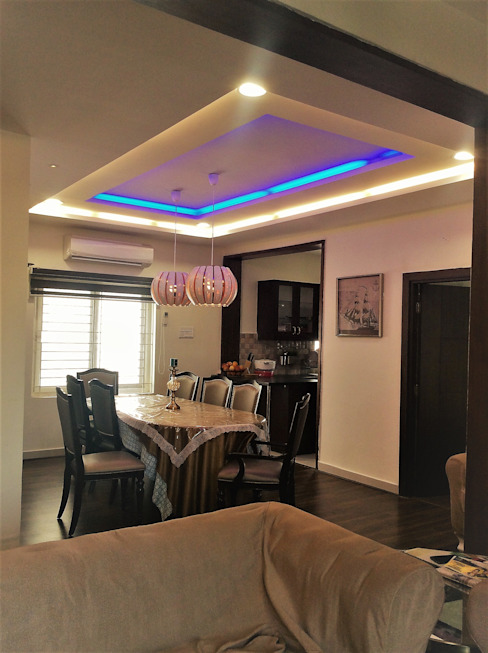 Hanging Lights over the Dining Table:  Dining room by Urban Shaastra