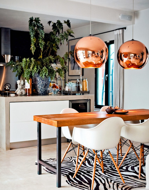 Copper Focused Kitchen/Dining Space by Gracious Luxury Interiors Mediterranean