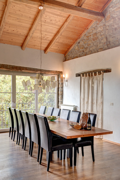 Rustic style dining room by Andrea Chiesa è Progetto Immagine Rustic Wood Wood effect