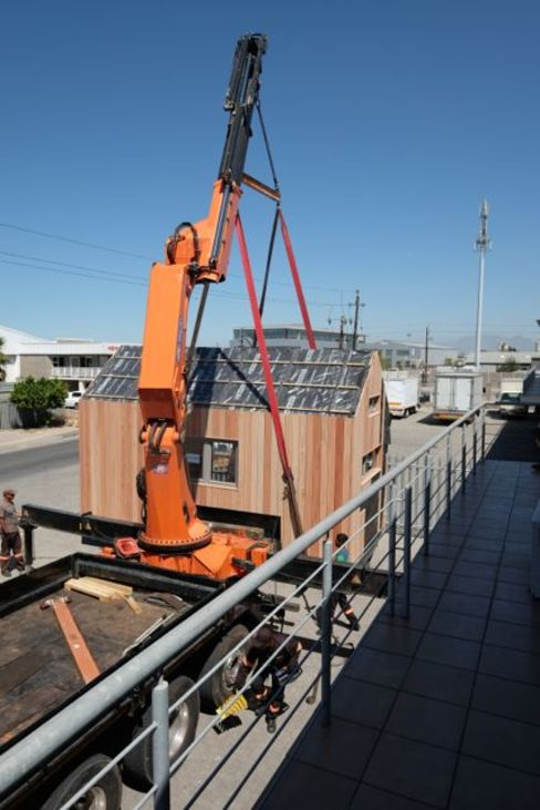 Hoisting the pod house onto the truck. by Greenpods
