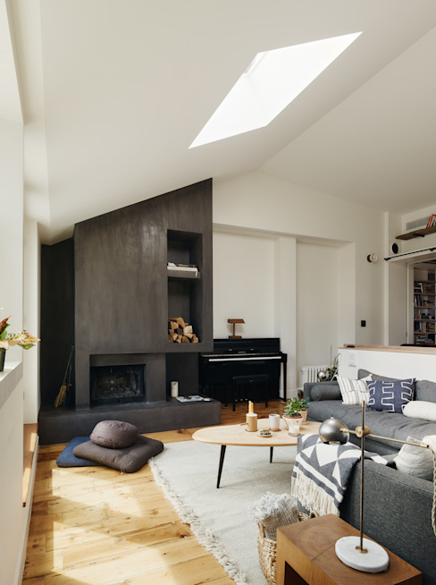 Living Room with Concrete Fireplace Modern living room by General Assembly Modern Concrete