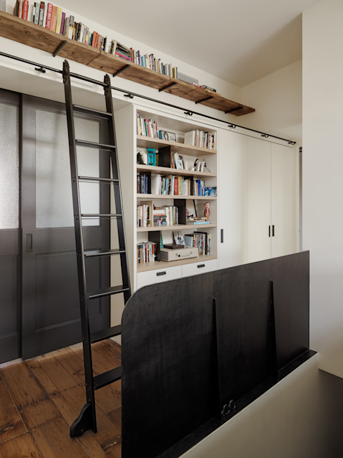 Library wall with movable ladder and oak and steel details Modern Study Room and Home Office by General Assembly Modern
