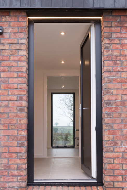 View through entrance:  Houses by guy taylor associates, Modern Bricks