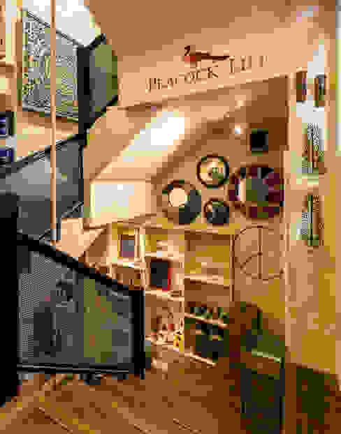 PEACOCK LIFE SHOWROOM Rustic style corridor, hallway & stairs by Turiya Lifestyle LLP Rustic Wood Wood effect