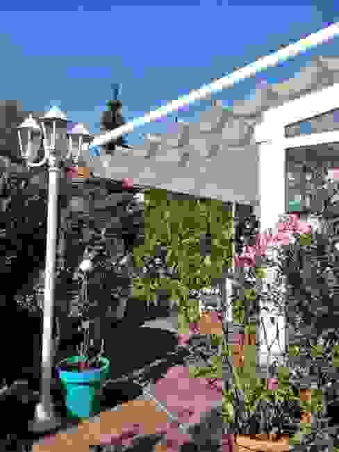 Varandas, marquises e terraços modernos por SPIN Bobko i Staniewski sp.j. Moderno Alumínio/Zinco