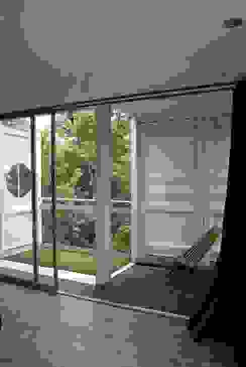 Terrazas de estilo  por TARE arquitectos , Moderno