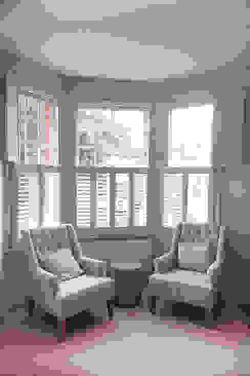 Living room shutters for bay windows:  Living room by Plantation Shutters Ltd,