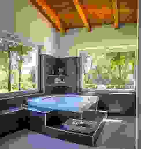 Baños de estilo  por Costantini Case in Legno,