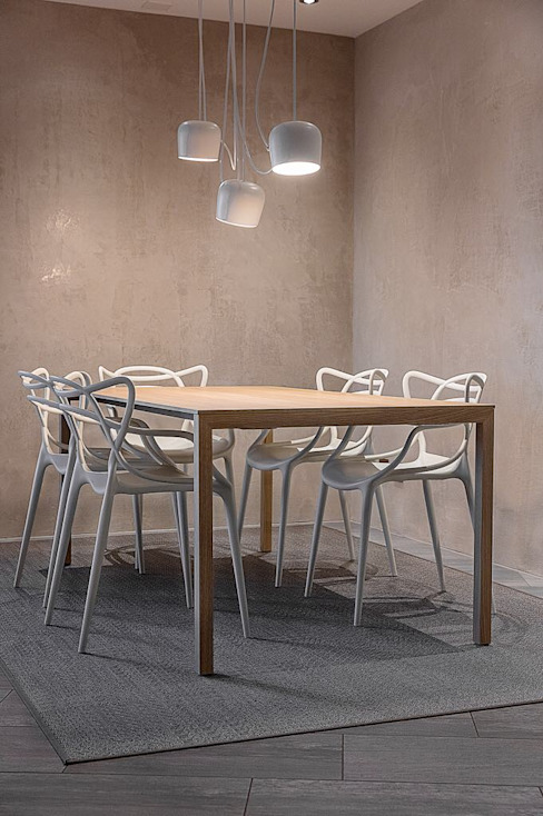 Rigore e colore MD Creative Lab - Architettura & Design Sala da pranzo moderna Calcare Beige