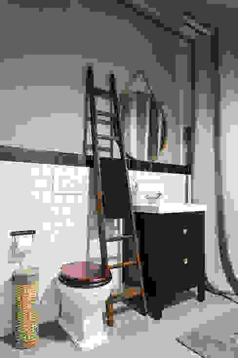 Banheiros industriais por NOMADE ARCHITETTURA E INTERIOR DESIGN Industrial