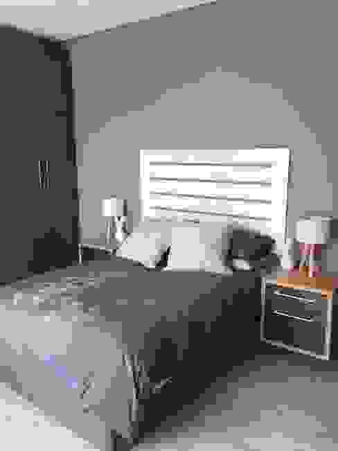 Dormitorios de estilo  por Graftink Interior and Architectural Design Studio , Moderno